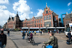 Amsterdam Centraal Station. Busy Amsterdam Centraal Station with Trams, Cyclists and tourists going about their daily business Stock Images