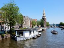 Amsterdam center - canal Oudeschans, canal houses with tower Montelbaanstoren Royalty Free Stock Images
