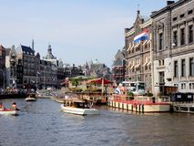 Amsterdam center, canal Rokin with monuments, boats Stock Photo