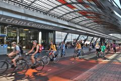 Amsterdam Centraal. AMSTERDAM, NETHERLANDS - JULY 9, 2017: Cyclists visit Amsterdam Central Station Centraal in the Netherlands. The station was opened in 1889 Stock Photography