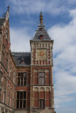 Amsterdam Centraal Railway Station. Single Clock Tower of Amsterdam Centraal Railway Station Royalty Free Stock Photos