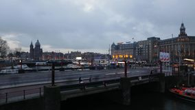 Amsterdam central station front side with moving people and trams. Time Lapse. stock video