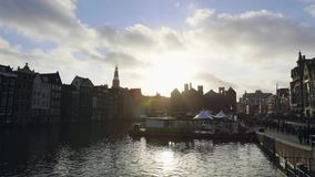 Amsterdam central station front side with moving people and trams. Time Lapse. stock video footage