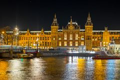 Amsterdam Central Station by night as Christmas time Netherlands. Amsterdam Central Station by night as Christmas time in the Netherlands Royalty Free Stock Image