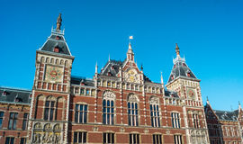 Amsterdam Central train station. Main entrance with a clear blue sky in the background Royalty Free Stock Photo