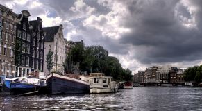 Amsterdam channel and river. Amsterdam channel - boat travel on a river - europe vacation Royalty Free Stock Photography