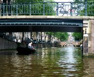 Amsterdam channel and river. Amsterdam channel - boat travel on a river - europe vacation Stock Images