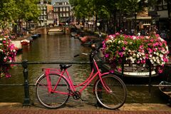 Amsterdam city bike on the canal bridge royalty free stock image