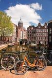 Amsterdam city with bikes on bridge Royalty Free Stock Photos