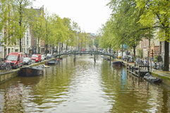 Amsterdam city canal on a cloudy autumn day Royalty Free Stock Photos