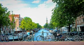 Channels and vintage bicycles on Amsterdam street. The capital of the Netherlands on a sunny summer day. Amsterdam city. Channels and vintage bicycles on Royalty Free Stock Photography