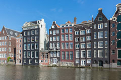 Amsterdam city with historic houses along Canals Stock Photos