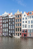 Amsterdam city with historic houses along Canals Royalty Free Stock Photography