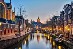 Amsterdam city at night with the canal in Amsterdam city, Nether stock photo