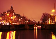 Amsterdam city by night in the Netherlands Stock Photo