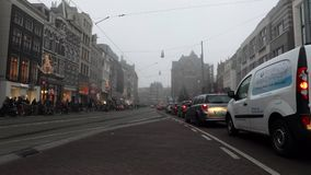 Amsterdam city road with different kinds moving transport at evening time. Time Lapse. AMSTERDAM, NETHERLANDS - JANUARY 05, 2017: Amsterdam city road with stock video