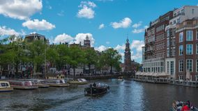 Amsterdam city skyline with Dutch buildings in Amsterdam city, Netherlands time lapse.Ams Central NX 4K. Amsterdam city skyline with Dutch buildings in Amsterdam stock video footage
