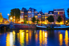 Amsterdam city view with Amstel river. At sunset Royalty Free Stock Images