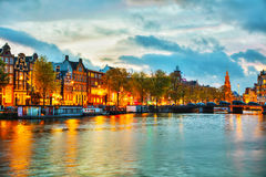 Amsterdam city view with Amstel river. At sunset Stock Photo