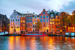 Amsterdam city view with Amstel river. At sunset Stock Photography