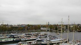 Amsterdam city view. With canal on rainy day stock video