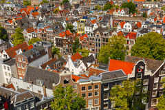 Amsterdam city view from Westerkerk, Holland, Netherlands. Roofs and facades of Amsterdam. City view from the bell tower of the church Westerkerk, Holland Royalty Free Stock Images