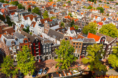 Amsterdam city view from Westerkerk, Holland, Netherlands. Roofs and facades of Amsterdam. City view from the bell tower of the church Westerkerk, Holland Royalty Free Stock Photo