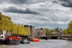 Amsterdam Cityscape from Amstel River Stock Photo