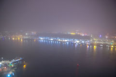 Amsterdam cityscape and beautiful mystic view from top at foggy night. Royalty Free Stock Images