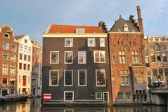 Amsterdam. Ciudad vieja por la tarde Fotos de archivo libres de regalías
