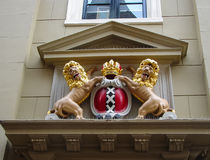 Amsterdam coat of arms on the facade of the city building. Royalty Free Stock Photo