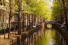 Amsterdam con il canale in Olanda Fotografia Stock