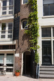 Amsterdam. Connection of modern and traditional architecture. Royalty Free Stock Image
