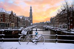 Amsterdam covered with snow with the Westerkerk in the Netherlands Royalty Free Stock Photo