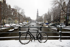Amsterdam covered with snow with the Westerkerk in Netherlands Royalty Free Stock Image
