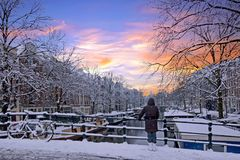 Free Amsterdam Covered With Snow In Winter In The Netherlands At Sun Stock Images - 125921004