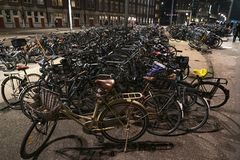 Amsterdam A crowded bicycle parking outside the central station at night royalty free stock photo