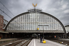 Amsterdam CS ominous. Amsterdam Central station on a dark and cloudy spring afternoon seen from the train platform stock photography