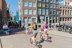 Amsterdam. Cyclists on city streets. Royalty Free Stock Image