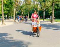 Amsterdam. Cyclists on city streets. Royalty Free Stock Photography