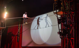 Amsterdam, 20 dec 2014: An acrobat from Circus Scott gives a blindfolded tightrope walking performance. Royalty Free Stock Image
