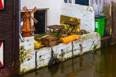 Amsterdam, die Niederlande - 14. Dezember 2017: Der berühmteste Kanal und der Damm in Amsterdam Lizenzfreies Stockbild