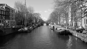 Amsterdam die Niederlande und Boote stockbild