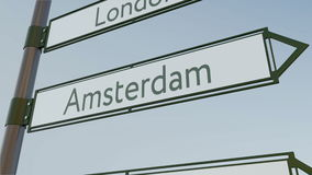 Amsterdam direction sign on road signpost with European cities captions. Conceptual 3D rendering. Amsterdam direction sign on road signpost with European cities Stock Photo