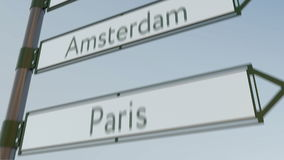 Amsterdam direction sign on road signpost with European cities captions. 4K conceptual clip. Amsterdam direction sign on road signpost with European cities stock footage