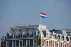 Amsterdam with the Dutch flag Royalty Free Stock Image