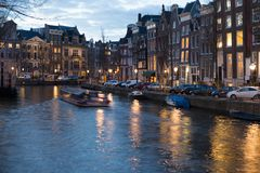 Amsterdam Europe old city centre street canal gracht night. Scene Stock Photos