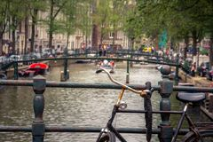 Amsterdam, with flowers and bicycles on the bridges over the canals, Holland, Netherlands. Royalty Free Stock Images