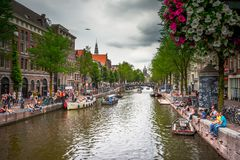 Amsterdam, with flowers and bicycles on the bridges over the canals, Holland, Netherlands. Royalty Free Stock Image
