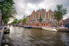 Amsterdam, with flowers and bicycles on the bridges over the canals, Holland, Netherlands. Royalty Free Stock Photo